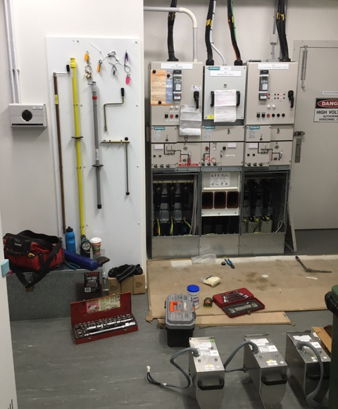 HV operator commissioning a new switchgear installation, providing isolation and earthing of high voltage circuit breakers and secondary circuits for the safe issue of Electrical Access Permits and Notice of Work on Apparatus